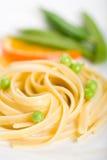 Pasta dei frutti di mare con i piselli Fotografia Stock