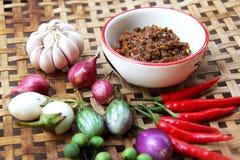 Pasta del peperoncino rosso con la verdura Immagini Stock