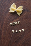 Pasta design. Beste mama funny pasta design on wooden background Royalty Free Stock Photography