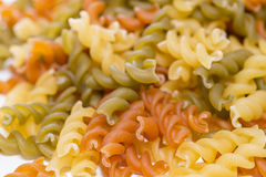 Pasta. Detail of a pile of uncooked macaroni stock photos