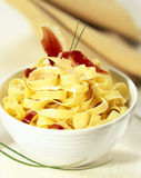 Pasta with diced foie gras and smoked duck breast Royalty Free Stock Images