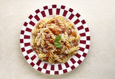 Pasta with diced ham and tomatoes. Food, gastronomy, cuisine,cookery Stock Photography