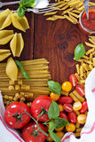 Pasta different types with tomatoes and basil Royalty Free Stock Photos