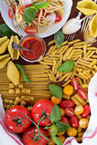 Pasta different types with tomatoes and basil Stock Images