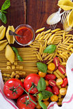 Pasta different types with tomatoes and basil Royalty Free Stock Images