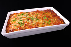 Pasta Dinner. A tray of freshly cooked pasta bake isolated on an angle Stock Photo