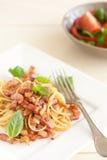 Pasta dish. Spaghetti with bacon, garlic, parmezan and basil Royalty Free Stock Photography