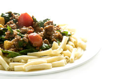 Pasta dish. Pasta with mince, spinach and tomato Stock Images