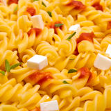 Pasta dish. With tomato and cheese stock photo