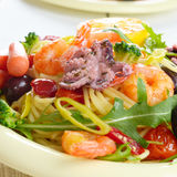 Pasta dish with octopus and shrimps Royalty Free Stock Images