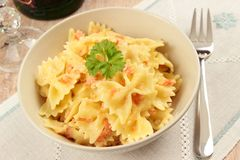 Tuscan farfalle with salmon Stock Images