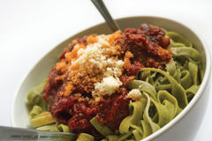 Pasta Meal. Spinach tagliatelle with tomato sauce Stock Image