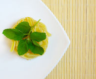 Pasta dishes seasoned with mint Royalty Free Stock Photos