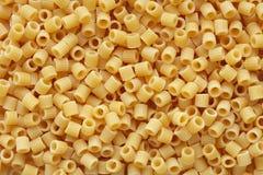 Pasta ditalini background stock images