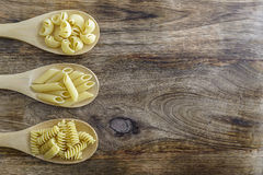 Pasta. Divided into wooden spoons Royalty Free Stock Photo