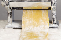 Pasta dough is being processed Stock Images