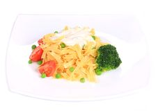 Pasta with dressing and green beans. Stock Image