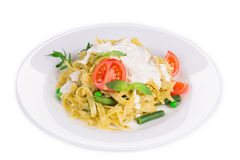 Pasta with dressing and green beans. Royalty Free Stock Image