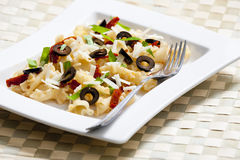 Pasta with dried tomatoes. And olives Stock Photo