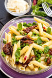 Pasta with dried tomatoes and peas Royalty Free Stock Images