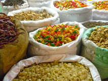Pasta and dried vegetables in bags Stock Image