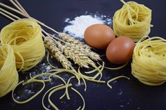 Pasta from durum wheat,the ears of corn. stock image