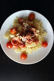 Pasta. Of durum wheat with grilled sausages, tomatoes and grated cheese stock images