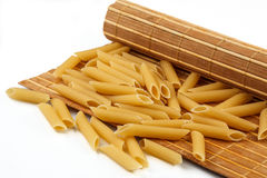 Pasta from durum wheat on the mat Royalty Free Stock Image