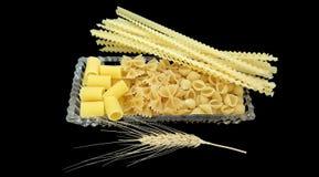 Pasta e un orecchio Fotografia Stock
