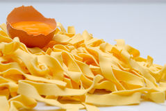Pasta and egg. Fresh egg and noodles on white background Royalty Free Stock Photo
