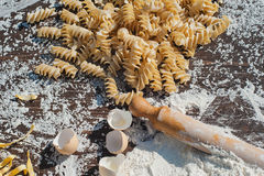 Pasta egg in flour and a rolling piñon wood and rustic table. Pasta egg in flour and a rolling pin stock photos