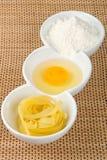 Pasta, egg yolk and flour Stock Photos