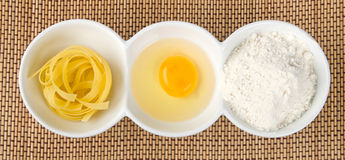 Pasta, egg yolk and flour Royalty Free Stock Photography