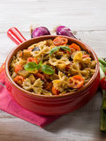 Pasta with eggplants and pachino Stock Photo