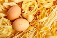 Pasta and eggs Stock Photos