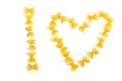 Pasta farfalle arranged heart shape Stock Photography