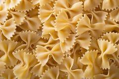 Pasta farfalle background Stock Photography