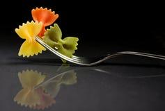 Pasta farfalle on a fork Stock Photography