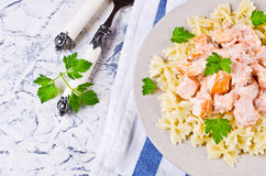 Pasta farfalle with salmon Stock Image