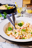 Pasta farfalle with salmon Stock Photo
