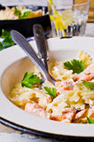 Pasta farfalle with salmon Stock Photos