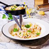 Pasta farfalle with salmon Stock Images