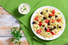 Pasta Farfalle with Smoked Salmon and black olives Stock Image