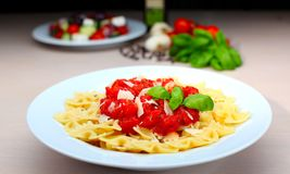 Pasta farfalle with tomato sauce and basil Stock Photos