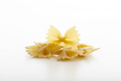 Pasta farfalle on white background. Raw farfalle on white background Royalty Free Stock Images