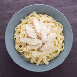 Pasta fettuccine alfredo with chicken and parmesan Stock Photos