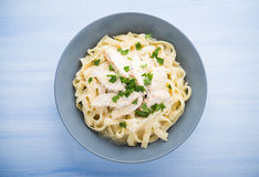Pasta fettuccine alfredo with chicken, parmesan and parsley Royalty Free Stock Photography