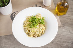 Pasta fettuccine alfredo with chicken, parmesan and parsley on w Royalty Free Stock Photos