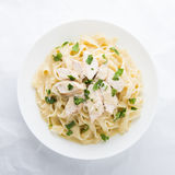Pasta fettuccine alfredo with chicken, parmesan and parsley Royalty Free Stock Photo