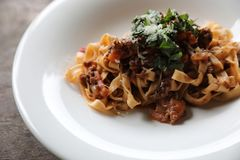 Pasta Fettuccine Bolognese with beef and tomato sauce. On a dish in close up royalty free stock photo